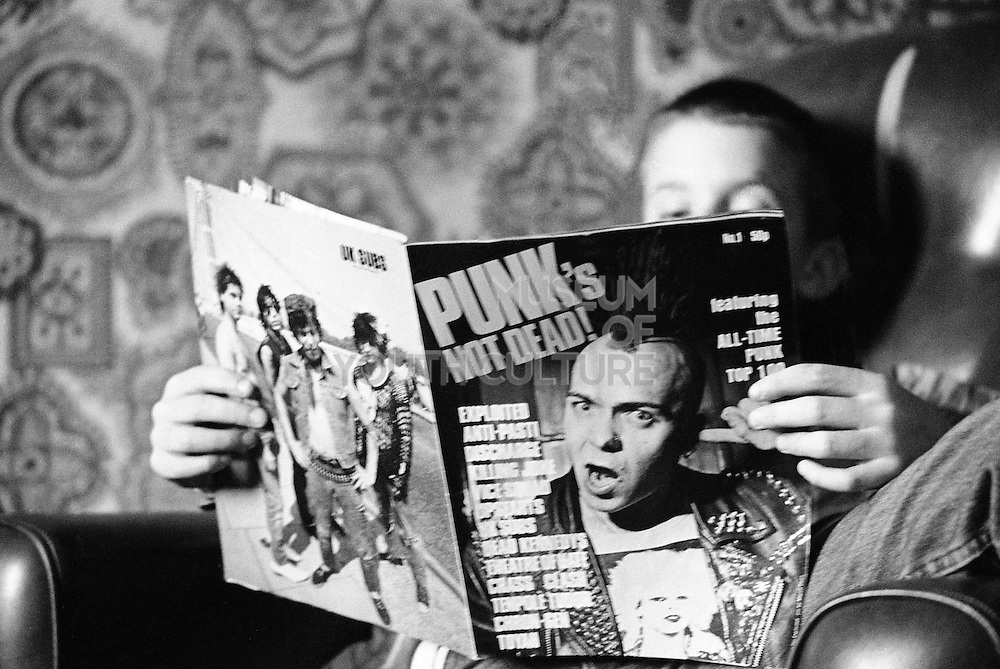Nev reading Punks not Dead magazine, Hawthorne Rd, High Wycombe, UK, 1980s.