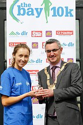 No fee for Repro:.Caroline Crowley, third place lady in a time of 37.31 minutes at the DLR Bay 10K road race pictured been presented with her prize by An Cathaoirleach Cllr Tom Joyce, Dun Laoghaire-Rathdown County Council. Pic Jason Clarke Photography