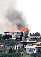 Flames explode next to house in a mountain subdivision west of Colorado Springs, Colorado June 24, 2012.  Firefighters in Western U.S. states struggled to contain out-of-control wind-stoked wildfires across the U.S. west as summer temperatures mounted, and a fresh blaze consumed more homes in Colorado.  REUTERS/Rick Wilking (UNITED STATES)