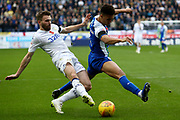 Leeds United midfielder Stuart Dallas (15)and Wigan Athletic defender Antonee Robinson (3) during the EFL Sky Bet Championship match between Wigan Athletic and Leeds United at the DW Stadium, Wigan, England on 4 November 2018.