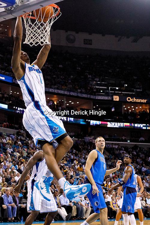 November 17, 2010; New Orleans, LA, USA; New Orleans Hornets small forward Trevor Ariza (1) dunks during the second half against the Dallas Mavericks at the New Orleans Arena. The Hornets defeated the Mavericks 99-97. Mandatory Credit: Derick E. Hingle