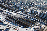 Nederland, Utrecht, Utrecht-West, 31-01-2010; spoorweg emplacement, het opstelterrein zuid (OZ) van Nedtrain; huizenblokken in de sneeuw.rail yard of Nedtrain; Utrecht as railway junction,.luchtfoto (toeslag), aerial photo (additional fee required).foto/photo Siebe Swart