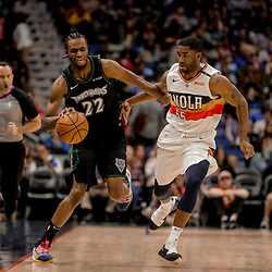 Dec 31, 2018; New Orleans, LA, USA; Minnesota Timberwolves forward Andrew Wiggins (22) drives past New Orleans Pelicans guard E'Twaun Moore (55) during the first quarter at the Smoothie King Center. Mandatory Credit: Derick E. Hingle-USA TODAY Sports