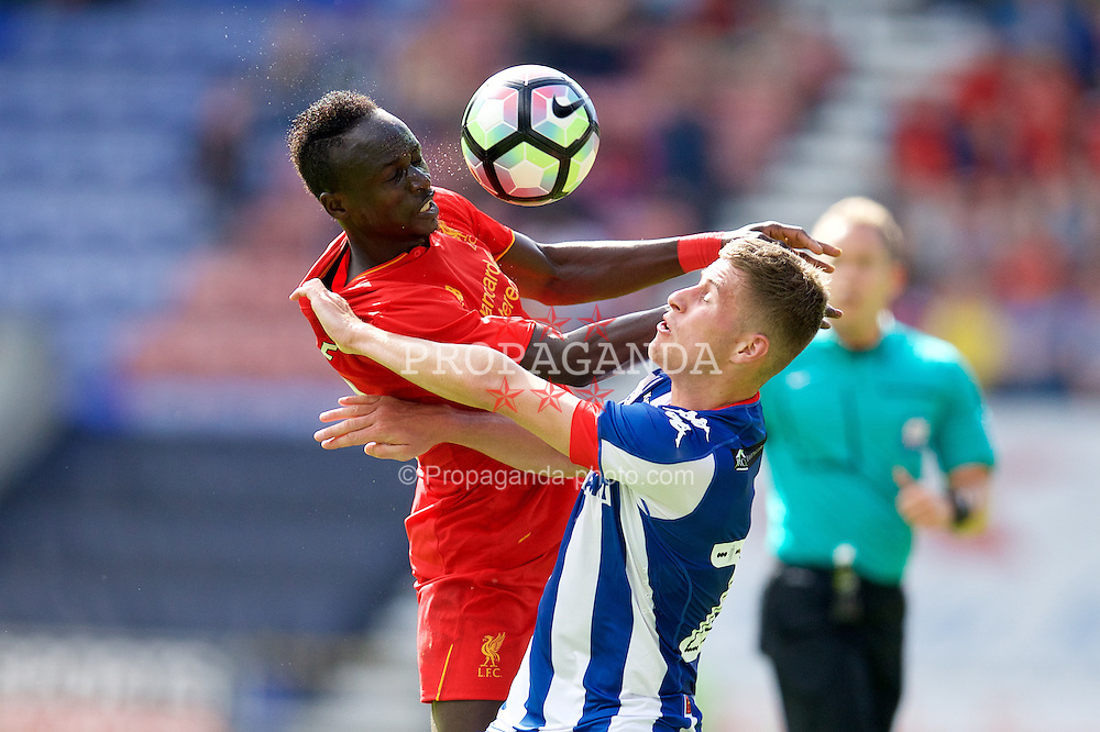 WIGAN, ENGLAND - Sunday, July 17, 2016: Liverpool's Sadio Mane in action against Wigan Athletic's Ryan Colclough during a pre-season friendly match at the DW Stadium. (Pic by David Rawcliffe/Propaganda)