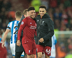LIVERPOOL, ENGLAND - Friday, April 26, 2019: Liverpool's Alex Oxlade-Chamberlain (L) and Trent Alexander-Arnold celebrate after the FA Premier League match between Liverpool FC and Huddersfield Town AFC at Anfield. Liverpool won 5-0. (Pic by David Rawcliffe/Propaganda)