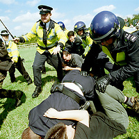 Police attack Animal Rights protesters campaigning to close Shamrock Farm near Brighton, Sussex which imported mokeys for use in animal experimentation. The protesters eventually won their fight and the farm was forced to close a few months after this picture was taken in. 1999.<br />