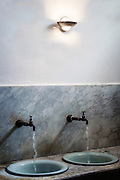 two vintage washbasins with running water taps