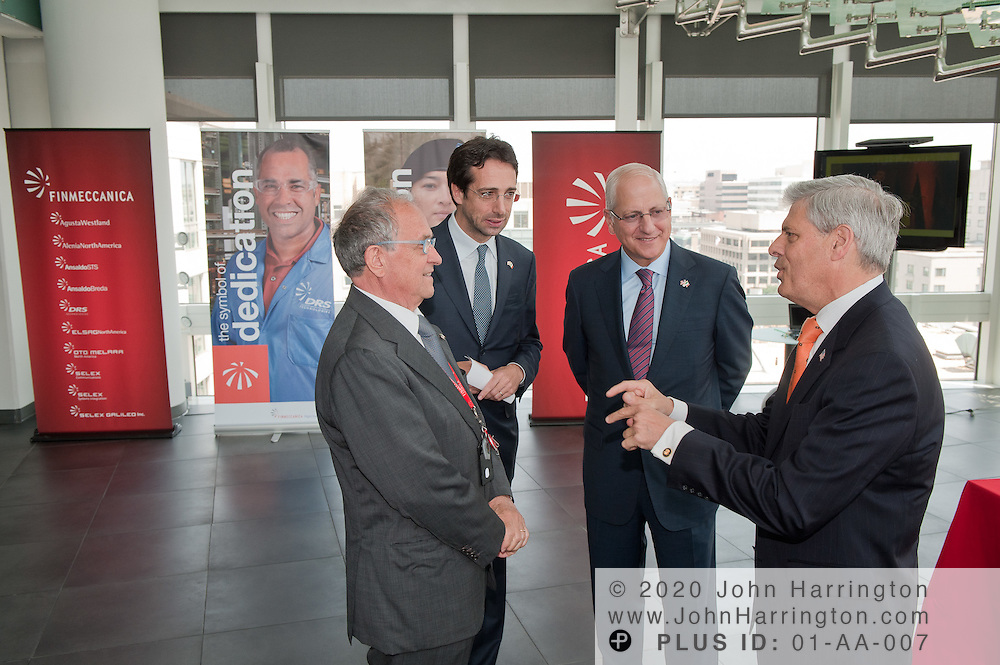 The Sons of Italy Foundation National Executive Director and CEO, Phil Piccigallo (right) presents Pier Francesco Guarguaglini (center), President of Finmeccanica SPA and Simone Bemporad (left), CEO of Finmeccanica North America with an award for Excellence in Global Business at the Finmeccanica offices in Washington, DC on June, 8th 2011.