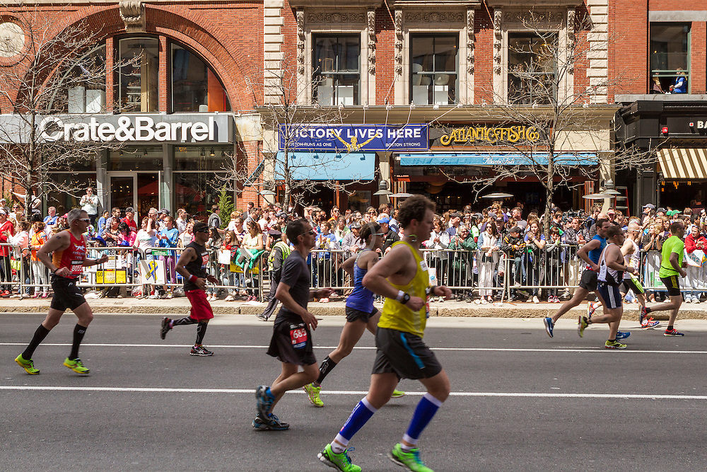 2014 Boston Marathon: runners in homestretch on Boylston Street at site of second bombing one year ago