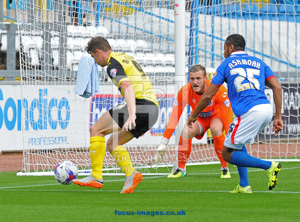 Matt McClure of Dagenham &amp; Redbridge (left) clears the ball away in Dagenham &amp; Redbridge penalty box during the Sky Bet League 2 match at Brunton Park, Carlisle<br /> Picture by Greg Kwasnik/Focus Images Ltd +44 7902 021456<br /> 12/09/2015