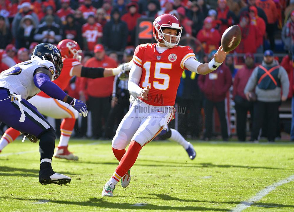 Dec 9, 2018; Kansas City, MO, USA; Kansas City Chiefs quarterback Patrick Mahomes (15) laterals the ball during the first half against the Baltimore Ravens at Arrowhead Stadium. Mandatory Credit: Denny Medley-USA TODAY Sports
