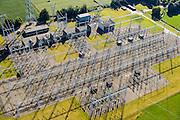 Nederland, Gelderland,  Gemeente Neder-Betuwe, 30-09-2015; transformator station Dodewaard (trafostation) voor verdelen van stroom met extra hoge spanning van het landelijk koppelnet naar de lokale netwerk(en) met lagere spanning. Van 380 kV naar 150 kV. Ook aangeduid als schakelstation.<br /> Dodewaard transformer station for distribution of power with extra high voltage of the national grid to the local network (s) with lower voltage. From 380 kV to 150 kV.<br /> <br /> Nursery of trees, bushes, shrubs and plants.<br /> luchtfoto (toeslag op standard tarieven);<br /> aerial photo (additional fee required);<br /> copyright foto/photo Siebe Swart