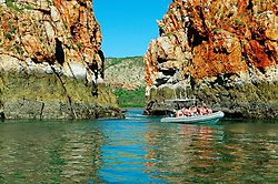 Passengers enjoy a ride through the horizontal waterfalls.