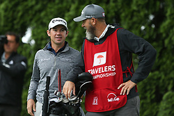 June 23, 2018 - Cromwell, Connecticut, United States - Brian Harman (L) and his caddie wait on the 9th tee during the third round of the Travelers Championship at TPC River Highlands. (Credit Image: © Debby Wong via ZUMA Wire)
