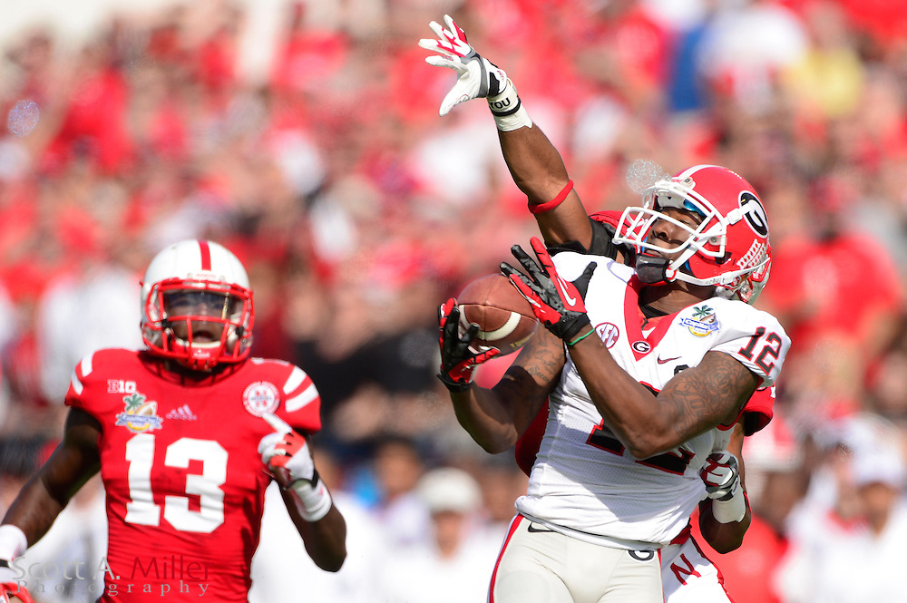 Georgia Bulldogs receiver Tavarres King (12) catches a touchdown pass against the Nebraska Cornhuskers in the Capital One Bowl at the Florida Citrus Bowl on Jan 1, 2013 in Orlando, Florida. ..©2012 Scott A. Miller..