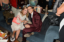 CAGGIE DUNLOP and OLIVER PROUDLOCK at a private view of the Beulah Winter Autumn Winter collection entitled 'Chrysalis' held at The South Kensington Club, London SW7 on 24th September 2015.