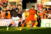 Dundee midfielder Scott Allan (#10) looks to dribble the ball beyond Dundee United defender Lewis Toshney (#6) during the Betfred Scottish Cup match between Dundee and Dundee United at Dens Park, Dundee, Scotland on 9 August 2017. Photo by Craig Doyle.