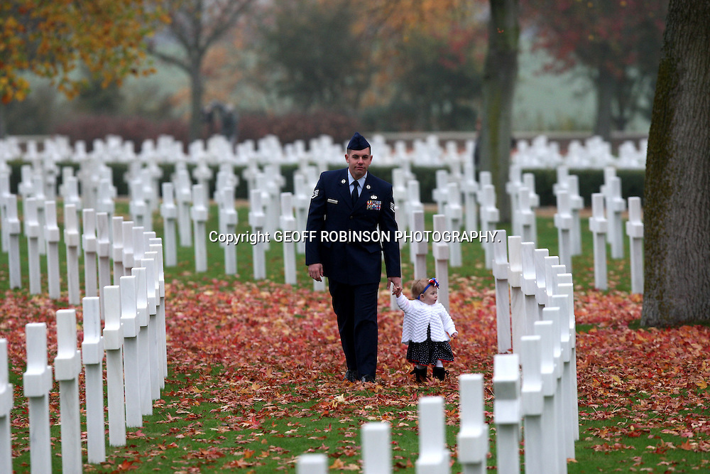 AMERICAN SERVICEMEN JOSHUA DONAHUE FROM RAF MOLESWORTH,CAMBS, WITH HIS DAUGHTER ADDELYNE  AT THE REMEMBERANCE DAY SERVICE AT THE AMERICAN WAR CEMETERY IN CAMBRIDGE ON NOW 11.. A special Remembrance Day ceremony has taken place today (Fri) at the American War Cemetery in Madingley, near Cambridge...More than 50 poppy wreaths were laid to honour the Americans buried in England who died in both world wars...The service featured members of the Royal Air Force and the US military and a minute's silence was held to commemorate the day...The war cemetery is the final resting place for 3,811 American soldiers. Most died in the Battle of the Atlantic or the air bombardment of northwest Europe...The 30.5 acres of land was given to the USA by Cambridge University to remember the fallen American servicemen...It was first established on December 7, 1943, the second anniversary of Pearl Harbour..