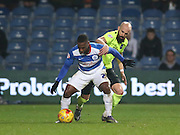 Queens Park Rangers midfielder David Hoilett (23) fends off Brighton defender, Bruno Saltor (2) during the Sky Bet Championship match between Queens Park Rangers and Brighton and Hove Albion at the Loftus Road Stadium, London, England on 15 December 2015.