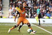 Hull City midfielder Moses Odubajo holds off Derby County midfielder Tom Ince during the Sky Bet Championship play-off first leg match between Derby County and Hull City at the iPro Stadium, Derby, England on 14 May 2016. Photo by Alan Franklin.
