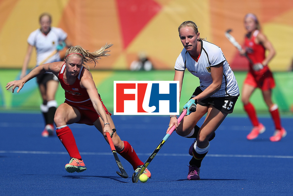 RIO DE JANEIRO, BRAZIL - AUGUST 15:  Hannah Kruger #15 of Germany moves the ball past Jill Witmer #10 of United States during the quarter final hockey game on Day 10 of the Rio 2016 Olympic Games at the Olympic Hockey Centre on August 15, 2016 in Rio de Janeiro, Brazil.  (Photo by Christian Petersen/Getty Images)