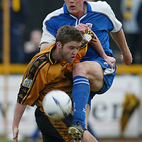 Alloa v St Johnstone.. 01.03.03<br />Ian Maxwell clears the ball from Ryan Davidson<br /><br />Pic by Graeme Hart<br />Copyright Perthshire Picture Agency<br />Tel: 01738 623350 / 07990 594431