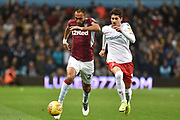 Aston Villa defender Ahmed Elmohamady (27) sprints forward with the ball `pursued by Nottingham Forest defender Tobias Figueiredo (3) during the EFL Sky Bet Championship match between Aston Villa and Nottingham Forest at Villa Park, Birmingham, England on 28 November 2018.