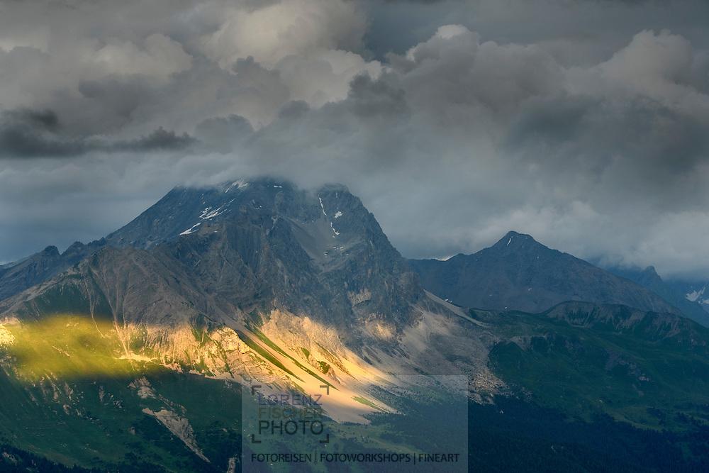Sonnenfleck auf dem Piz Mitgel von der Alp Stierva, Parc Ela, Graub&uuml;nden, Schweiz<br /> <br /> Sunbeam on the base of the Piz Mitgel from the alp Stierva, Parc Ela, Grisons, Switzerland