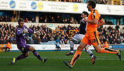 Millwall FC Forward Lee Gregory slots one past Colchester FC Goalkeeper Jamie Jones to put Millwall 1-0 up during the Sky Bet League 1 match between Millwall and Colchester United at The Den, London, England on 21 November 2015. Photo by Andy Walter.