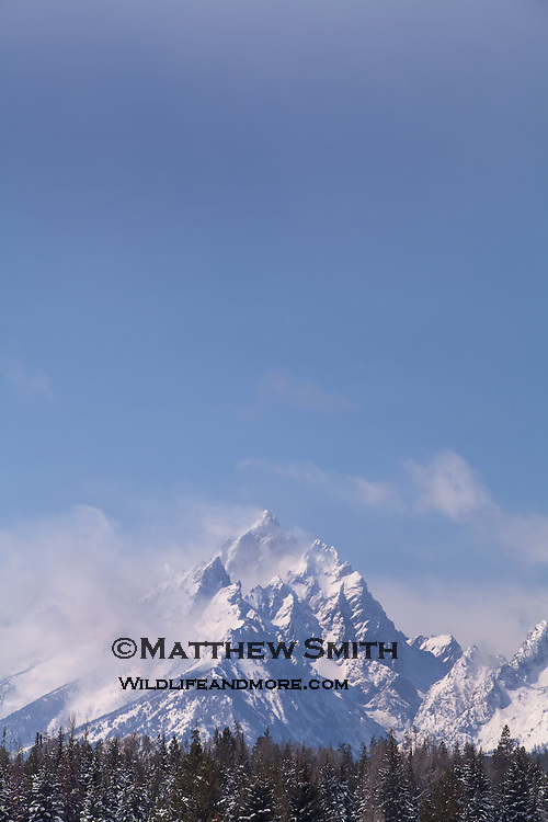 Grand Tetons with clouds and blue sky horizontal