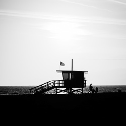 California lifeguard stand black and white picture. Lifeguard stand photo is high resolution and was taken at Santa Monica State Beach Park in Los Angeles County Southern California.