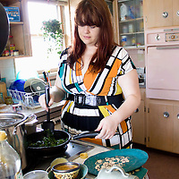 Before guests arrive, I (Sara Graca) fry ribbons of kale to garnish for my rustic root soup.