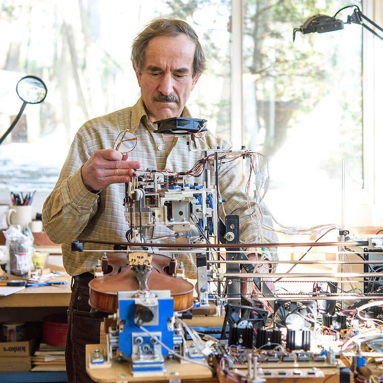 Bethesda, Maryland - January 28, 2015: Instead of miniaturizing blood catheters, retired NIH mechanical engineer Seth Goldstein makes kinetic sculpture robots. &quot;Ro-Bow,&quot; pictured, plays the violin. &quot;Why Knot&quot; ties a neck tie. Goldstein credits his wife for the names. &quot;Cram Guy,&quot; currently on display at the American Visionary Art Museum in Baltimore, is a crazy animated desk scene depicting a robot cramming for a test only to nod off to sleep. <br /> <br /> CREDIT: Matt Roth for The New York Times<br /> Assignment ID: 30169995A