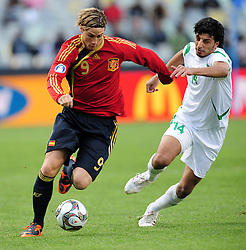 Torres and Salam Shaker  during the soccer match of the 2009 Confederations Cup between Spain and Iraq played at Vodacom Park,Bloemfontein,South Africa on 17 June 2009.  Photo: Gerhard Steenkamp/Superimage Media.
