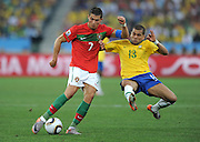 CRISTIANO RONALDO takes on DANI ALVES  during the 2010 FIFA World Cup South Africa Group G match between Portugal and Brazil at Durban Stadium on June 25, 2010 in Durban, South Africa.