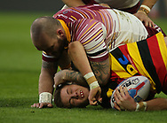 Dale Ferguson of Huddersfield Giants tackles Josh Guzdek of Dewsbury Rams during the Pre-season Friendly match at the John Smiths Stadium, Huddersfield<br /> Picture by Stephen Gaunt/Focus Images Ltd +447904 833202<br /> 14/01/2018