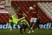 Nottingham Forest defender, on loan from Villarreal, Bojan Jokic (3)  fouls Brighton striker Jiri Skalak (38)  during the Sky Bet Championship match between Nottingham Forest and Brighton and Hove Albion at the City Ground, Nottingham, England on 11 April 2016. Photo by Simon Davies.
