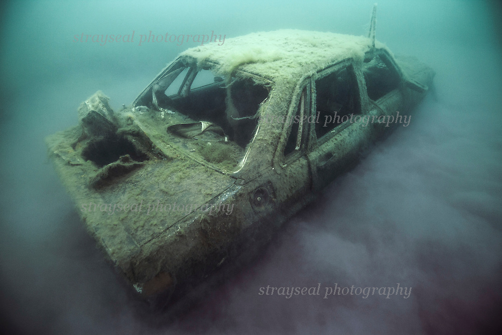 Uderwater car surrounded by hydrogen sulphide mist.