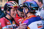 Elizabeth Armistead and Megan Guarnier celebrate after the Strade Bianche Women Elite race.