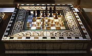 Games board, with chess pieces.  North Italian, about 1420-1450 bone, wood and horn. This board is for chess on one side and backgammon on the other.