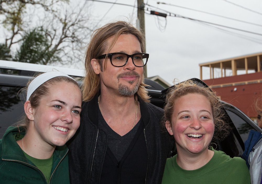 "Brad Pitt greets volunteer who work at his foundation  after giving   Ellen DeGeneres  a  tour in the "" Make it Right "" housing project in the Lower 9th Ward of New Orleans the day before a star-studded fundraising dinner  being held in New Orleans for his foundation."