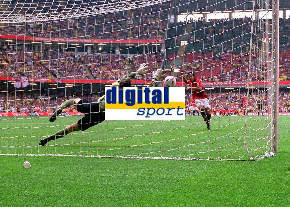 Ruud Van Nistelrooy (Utd) sees his penalty saved by Jens Lehmann (Arsenal). Manchester United v Arsenal. Community Shield.10/8/03. Millennium Stadium. Credit : Colorsport/Andrew Cowie.