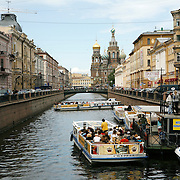 At the end of the canal is the Church of Our Savior on Spilled Blood, a Russian-style church was built on the spot where Emperor Alexander II was assassinated in Saint Petersburg on March 1881. <br /> <br /> Photography by Jose More