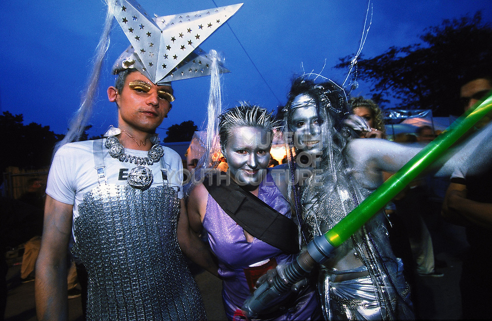 People in silver costumes at Paris Techno Parade, 1999