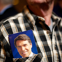 A supporter of Rick Perry listens to him speak during a town hall meeting at the VFW Post 10420 in advance of the South Carolina primary on 21 January.