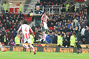 Vincent Company climbs above Kurt Zouma during the Premier League match between Stoke City and Manchester City at the Bet365 Stadium, Stoke-on-Trent, England on 12 March 2018. Picture by Graham Holt.