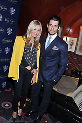 Left to right, LAURA WHITMORE and DAVID GANDY at the Johnnie Walker Blue Label and David Gandy partnership launch party held at Annabel's, 44 Berkeley Square, London on 5th February 2013.