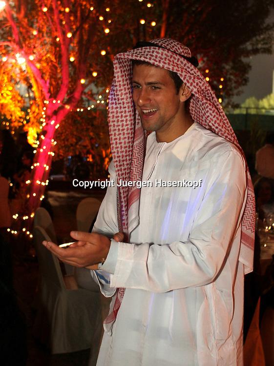 The Barclays Dubai Tennis Championships, ATP Tennis Turnier, United Arab Emirates,..V.A.E. Players Party, Spieler Party,..Novak Djokovic (SRB) in einem typisch arabischen Gewand...Foto: Juergen Hasenkopf..B a n k v e r b.  S S P K  M u e n ch e n, ..BLZ. 70150000, Kto. 10-210359,..+++ Veroeffentlichung nur gegen Honorar nach MFM,..Namensnennung und Belegexemplar. Inhaltsveraendernde Manipulation des Fotos nur nach ausdruecklicher Genehmigung durch den Fotografen...Persoenlichkeitsrechte oder Model Release Vertraege der abgebildeten Personen sind nicht vorhanden.