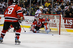Feb 20, 2007; East Rutherford, NJ, USA; New Jersey Devils goalie Martin Brodeur (30) makes a save during the third period at Continental Airlines Arena in East Rutherford, NJ.