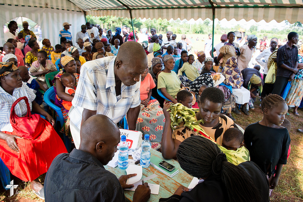 Residents from surrounding villages form a crowd as they register for the Mercy Medical Team clinic Thursday, June 12, 2014, at the Luanda Doho Primary School in Kakmega County, Kenya. LCMS Communications/Erik M. Lunsford